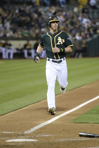 May 9, 2014; Oakland, CA, USA; Oakland Athletics right fielder Josh Reddick (16) scores on a RBI-single by second baseman Eric Sogard (28, not pictured) against the Washington Nationals during the fourth inning at O.co Coliseum. Mandatory Credit: Kyle Terada-USA TODAY Sports