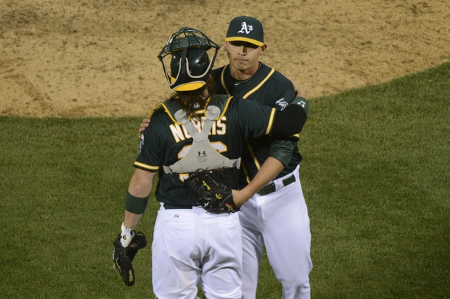 May 9, 2014; Oakland, CA, USA; Oakland Athletics relief pitcher Fernando Rodriguez (33, right) celebrates with catcher Derek Norris (36) after the game against the Washington Nationals at O.co Coliseum. The Athletics defeated the Nationals 8-0. Mandatory Credit: Kyle Terada-USA TODAY Sports