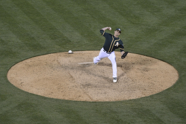 May 9, 2014; Oakland, CA, USA; Oakland Athletics relief pitcher Fernando Rodriguez (33) delivers a pitch during the ninth inning against the Washington Nationals at O.co Coliseum. The Athletics defeated the Nationals 8-0. Mandatory Credit: Kyle Terada-USA TODAY Sports
