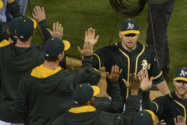 May 9, 2014; Oakland, CA, USA; Oakland Athletics first baseman Brandon Moss (37, right) celebrates with his team after the game against the Washington Nationals at O.co Coliseum. The Athletics defeated the Nationals 8-0. Mandatory Credit: Kyle Terada-USA TODAY Sports