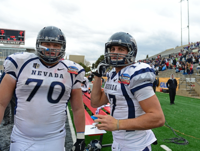 Dec. 15, 2012; Albuquerque, NM, USA; Nevada Wolf Pack offensive lineman Joel Bitonio (70) and quarterback Cody Fajardo (17) against the Arizona Wildcats in the 2012 New Mexico Bowl at University Stadium. Mandatory Credit: Mark J. Rebilas-USA TODAY Sports
