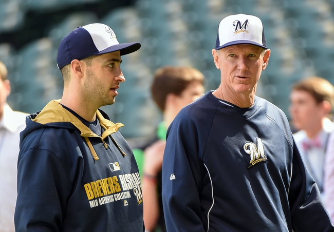 May 10, 2014; Milwaukee, WI, USA;  Milwaukee Brewers manager Ron Roenicke (right) talks to right fielder Ryan Braun, who is on the disable list, before game against the New York Yankees at Miller Park. Mandatory Credit: Benny Sieu-USA TODAY Sports