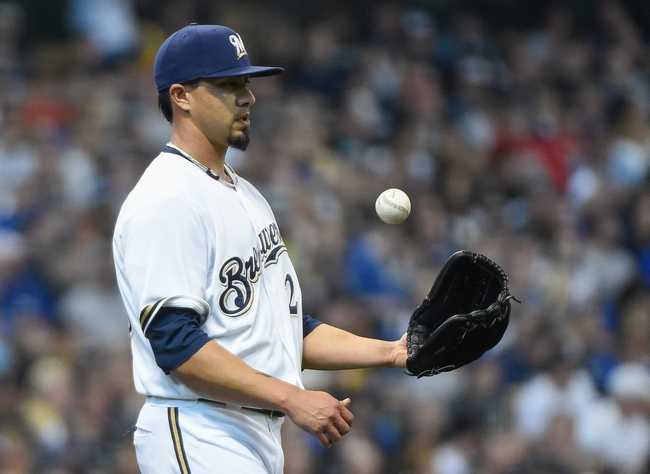 May 10, 2014; Milwaukee, WI, USA;  Milwaukee Brewers pitcher Kyle Lohse (26) reacts after giving up a run in the third inning against the New York Yankees at Miller Park. Mandatory Credit: Benny Sieu-USA TODAY Sports