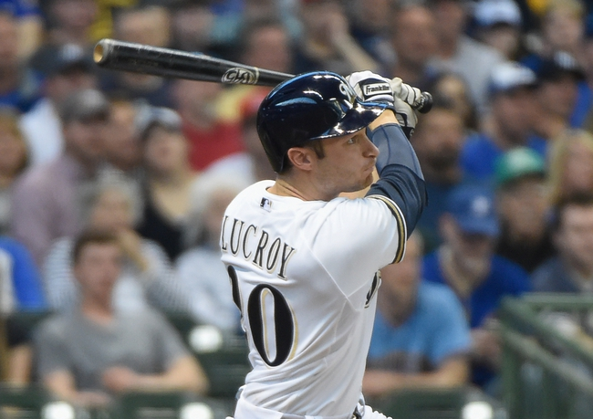 May 10, 2014; Milwaukee, WI, USA;  Milwaukee Brewers catcher Jonathan Lucroy (20) hits a 2-run homer in the third inning against the New York Yankees at Miller Park. Mandatory Credit: Benny Sieu-USA TODAY Sports