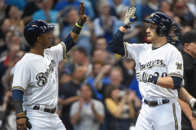 May 10, 2014; Milwaukee, WI, USA;  Milwaukee Brewers catcher Jonathan Lucroy (R) celebrates with shortstop Jean Segura (L) after hitting a 2-run home run in the third inning at Miller Park. Mandatory Credit: Benny Sieu-USA TODAY Sports