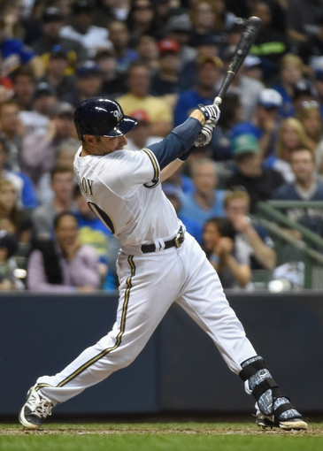 May 10, 2014; Milwaukee, WI, USA; Milwaukee Brewers catcher Jonathan Lucroy (20) hits a double off the wall in the seventh inning against the New York Yankees at Miller Park. Mandatory Credit: Benny Sieu-USA TODAY Sports