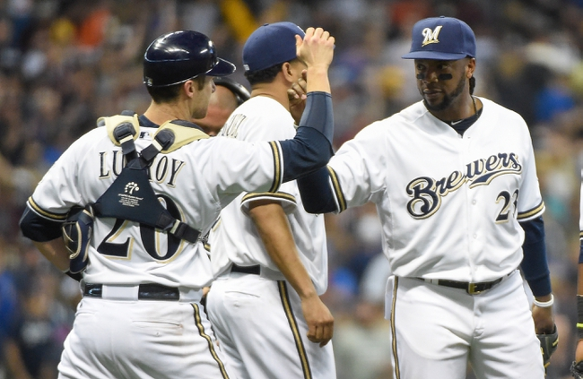 May 10, 2014; Milwaukee, WI, USA; Milwaukee Brewers catcher Jonathan Lucroy (20) celebrates with second baseman Rickie Weeks (23) celebrates after defeating the New York Yankees 5-4 at Miller Park. Mandatory Credit: Benny Sieu-USA TODAY Sports