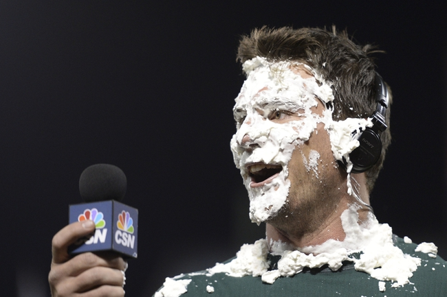 May 10, 2014; Oakland, CA, USA; Oakland Athletics catcher John Jaso (5) receives a pie from right fielder Josh Reddick (16, not pictured) after the game against the Washington Nationals at O.co Coliseum. The Athletics defeated the Nationals 4-3 in 10 innings. Mandatory Credit: Kyle Terada-USA TODAY Sports