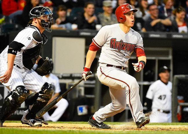 May 9, 2014; Chicago, IL, USA; Arizona Diamondbacks catcher Miguel Montero (26) during the fourth inning at U.S Cellular Field. Mandatory Credit: Mike DiNovo-USA TODAY Sports