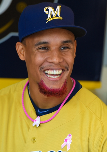 May 11, 2014; Milwaukee, WI, USA; Milwaukee Brewers center fielder Carlos Gomez (27) celebrates Mothers Day against the New York Yankees at Miller Park. Mandatory Credit: Benny Sieu-USA TODAY Sports
