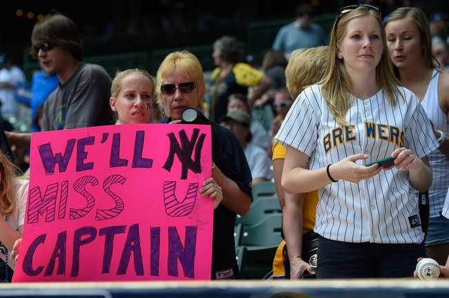 May 11, 2014; Milwaukee, WI, USA;  Fans hold a sign from the stands for New York Yankees shortstop Derek Jeter (not pictured) after a ceremony honoring him prior to game against the Milwaukee Brewers at Miller Park. Mandatory Credit: Benny Sieu-USA TODAY Sports