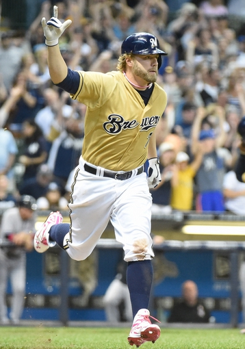 May 11, 2014; Milwaukee, WI, USA; Milwaukee Brewers first baseman Mark Reynolds (M) celebrates after hitting the game-winning single in the ninth inning to defeat the New York Yankees 6-5 at Miller Park. Mandatory Credit: Benny Sieu-USA TODAY Sports