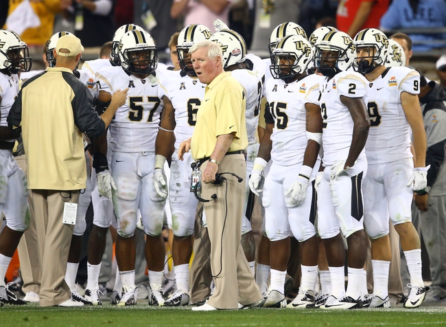 Jan 1, 2014; Glendale, AZ, USA; Central Florida Knights head coach George O'Leary (center) against the Baylor Bears during the Fiesta Bowl at University of Phoenix Stadium. Mandatory Credit: Mark J. Rebilas-USA TODAY Sports