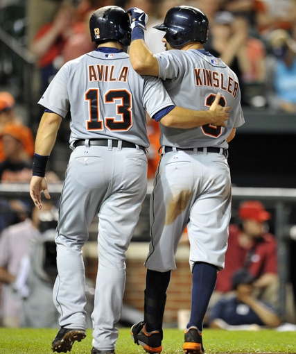May 12, 2014; Baltimore, MD, USA; Detroit Tigers second baseman Ian Kinsler (3) is congratulated by Alex Avila (13) after hitting a two-run home run in the eighth inning against the Baltimore Orioles at Oriole Park at Camden Yards. The Tigers defeated the Orioles 4-1. Mandatory Credit: Joy R. Absalon-USA TODAY Sports