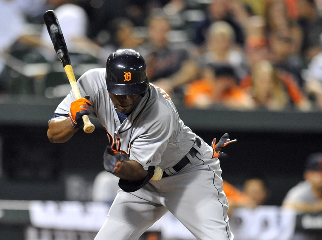 May 12, 2014; Baltimore, MD, USA; Detroit Tigers right fielder Torii Hunter (48) is hit by a pitch in the eighth inning against the Baltimore Orioles at Oriole Park at Camden Yards. The Tigers defeated the Orioles 4-1. Mandatory Credit: Joy R. Absalon-USA TODAY Sports