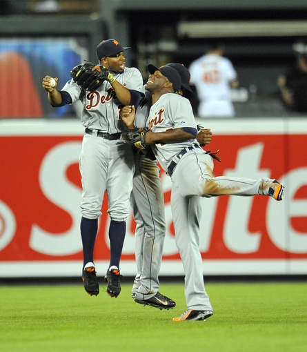 May 12, 2014; Baltimore, MD, USA; Detroit Tigers outfielders Rajai Davis (left) Torii Hunter (right) and Austin Jackson (rear) celebrate after a game against the Baltimore Orioles at Oriole Park at Camden Yards. The Tigers defeated the Orioles 4-1. Mandatory Credit: Joy R. Absalon-USA TODAY Sports