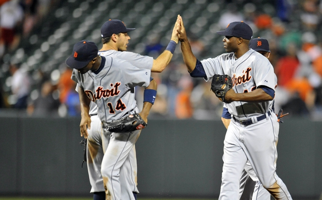 May 12, 2014; Baltimore, MD, USA; Detroit Tigers teammates Ian Kinsler (3) and Torii Hunter (48) celebrate after a game against the Baltimore Orioles at Oriole Park at Camden Yards. The Tigers defeated the Orioles 4-1. Mandatory Credit: Joy R. Absalon-USA TODAY Sports