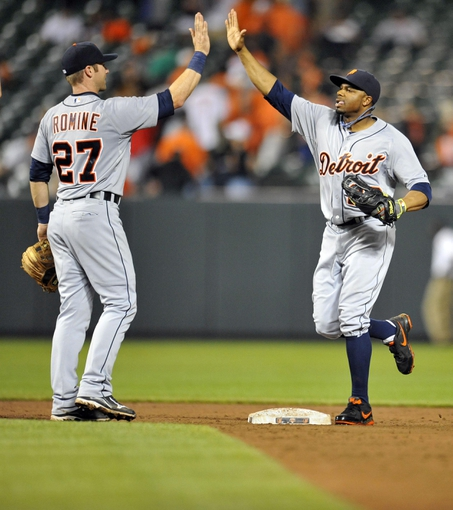 May 12, 2014; Baltimore, MD, USA; Detroit Tigers teammates Andrew Romine (27) and Rajai Davis (20) celebrate after a game against the Baltimore Orioles at Oriole Park at Camden Yards. The Tigers defeated the Orioles 4-1. Mandatory Credit: Joy R. Absalon-USA TODAY Sports