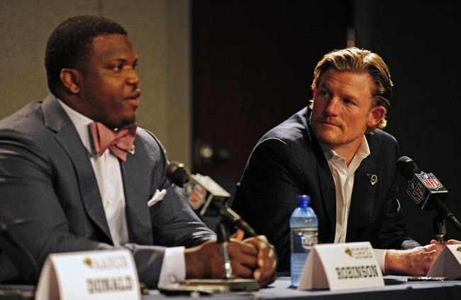 May 13, 2014; St. Louis, MO, USA; St. Louis Rams general manager Les Snead looks on as first-round pick offensive lineman Greg Robinson talks with the media during a press conference at Rams Park. Mandatory Credit: Jeff Curry-USA TODAY Sports