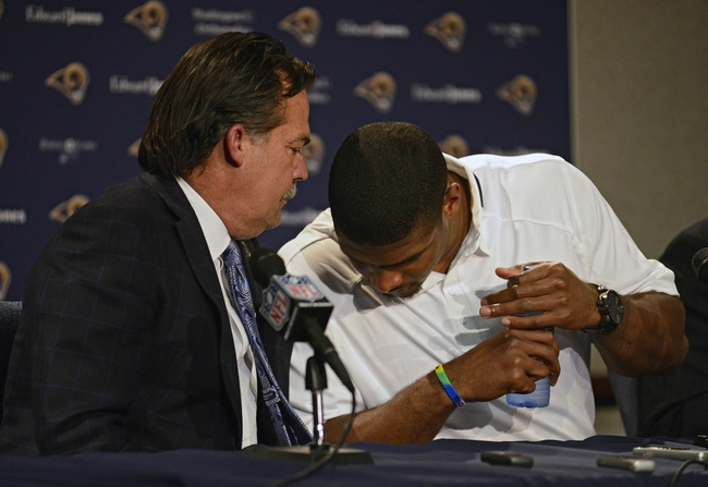 May 13, 2014; St. Louis, MO, USA; St. Louis Rams head coach Jeff Fisher (left) talks with seventh round pick defensive end Michael Sam during a press conference at Rams Park. Mandatory Credit: Jeff Curry-USA TODAY Sports
