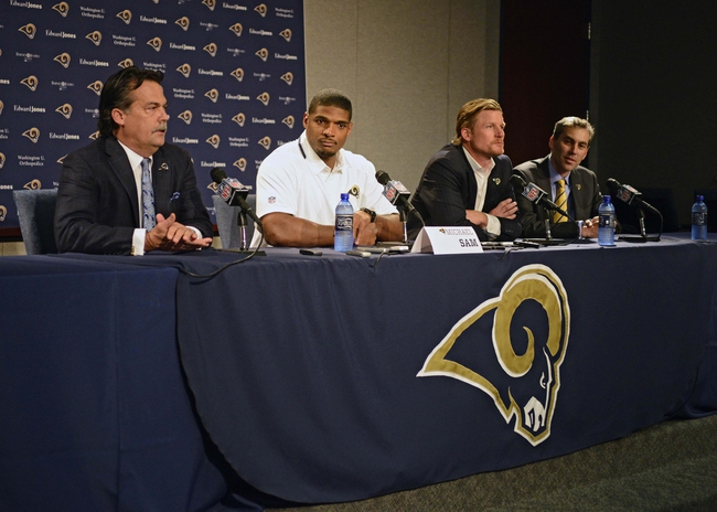 May 13, 2014; St. Louis, MO, USA; St. Louis Rams head coach Jeff Fisher (left), seventh round pick defensive end Michael Sam (middle) , general manager Les Snead (second from right) and executive vice president Kevin Demoff talk with the media during a press conference at Rams Park. Mandatory Credit: Jeff Curry-USA TODAY Sports