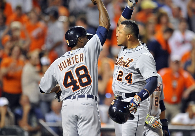 May 13, 2014; Baltimore, MD, USA; Detroit Tigers first baseman Miguel Cabrera (24) is congratulated by Torii Hunter (48) after hitting the game-winning three-run home run in the ninth inning against the Baltimore Orioles at Oriole Park at Camden Yards. The Tigers defeated the Orioles 4-1. Mandatory Credit: Joy R. Absalon-USA TODAY Sports