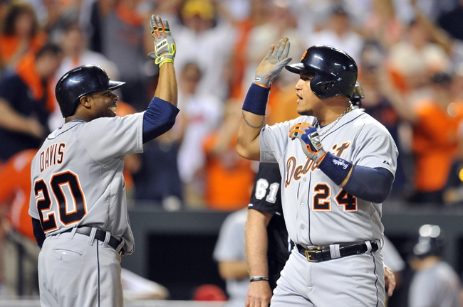 May 13, 2014; Baltimore, MD, USA; Detroit Tigers first baseman Miguel Cabrera (24) is congratulated by Rajai Davis (20) after hitting the game-winning three-run home run in the ninth inning against the Baltimore Orioles at Oriole Park at Camden Yards. The Tigers defeated the Orioles 4-1. Mandatory Credit: Joy R. Absalon-USA TODAY Sports