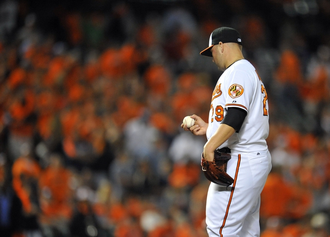 May 13, 2014; Baltimore, MD, USA; Baltimore Orioles pitcher Tommy Hunter (29) waits to be pulled from the game after giving up back-to-back home runs in the ninth inning against the Detroit Tigers at Oriole Park at Camden Yards. The Tigers defeated the Orioles 4-1. Mandatory Credit: Joy R. Absalon-USA TODAY Sports