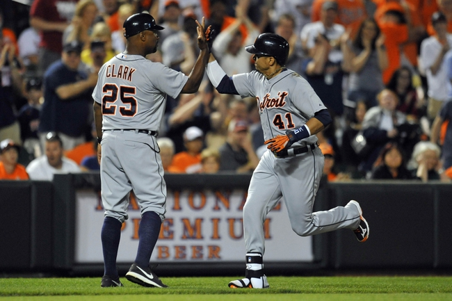 May 13, 2014; Baltimore, MD, USA; Detroit Tigers first baseman Victor Martinez (41) is congratulated by third base coach Dave Clark (25) after hitting a solo home run in the ninth inning against the Baltimore Orioles at Oriole Park at Camden Yards. The Tigers defeated the Orioles 4-1. Mandatory Credit: Joy R. Absalon-USA TODAY Sports