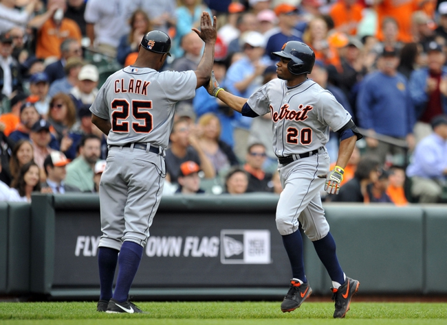 May 14, 2014; Baltimore, MD, USA; Detroit Tigers left fielder Rajai Davis (20) is congratulated by third base coach Dave Clark (25) after hitting a solo home run in the sixth inning against the Baltimore Orioles at Oriole Park at Camden Yards. The Tigers defeated the Orioles 7-5 completing the three game sweep. Mandatory Credit: Joy R. Absalon-USA TODAY Sports