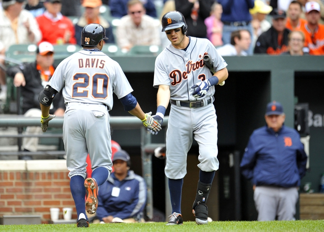 May 14, 2014; Baltimore, MD, USA; Detroit Tigers left fielder Rajai Davis (20) is congratulated by Ian Kinsler (3) after hitting a solo home run in the sixth inning against the Baltimore Orioles at Oriole Park at Camden Yards. The Tigers defeated the Orioles 7-5 completing the three game sweep. Mandatory Credit: Joy R. Absalon-USA TODAY Sports