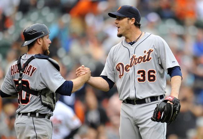 May 14, 2014; Baltimore, MD, USA; Detroit Tigers catcher Bryan Holaday (50) congratulates pitcher Joe Nathan (36) after a game against the Baltimore Orioles at Oriole Park at Camden Yards. The Tigers defeated the Orioles 7-5 completing the three game sweep. Mandatory Credit: Joy R. Absalon-USA TODAY Sports