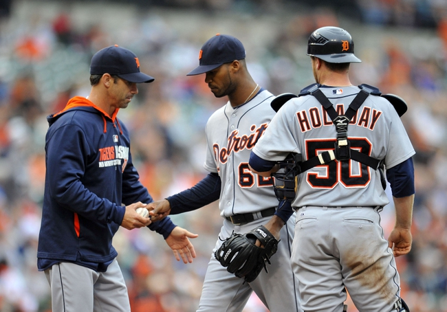 May 14, 2014; Baltimore, MD, USA; Detroit Tigers manager Brad Ausmus (7) takes the ball from reliever Al Alburquerque (62) in the seventh inning against the Baltimore Orioles at Oriole Park at Camden Yards. The Tigers defeated the Orioles 7-5 completing the three game sweep. Mandatory Credit: Joy R. Absalon-USA TODAY Sports