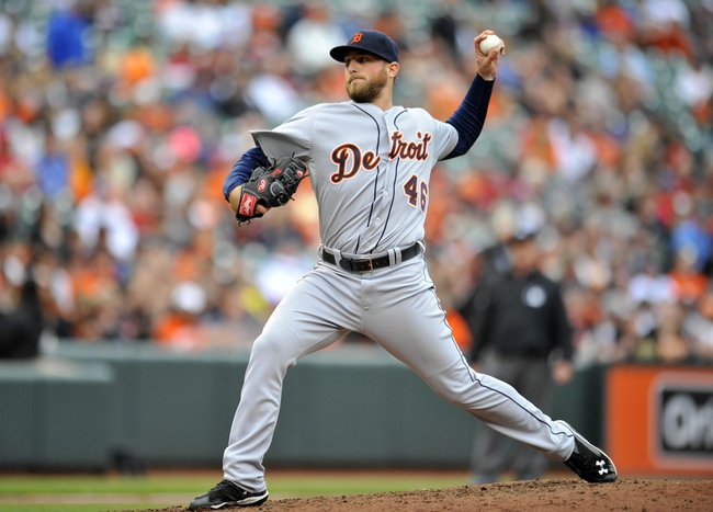 May 14, 2014; Baltimore, MD, USA; Detroit Tigers pitcher Ian Krol (46) throws in the seventh inning against the Baltimore Orioles at Oriole Park at Camden Yards. The Tigers defeated the Orioles 7-5 completing the three game sweep. Mandatory Credit: Joy R. Absalon-USA TODAY Sports