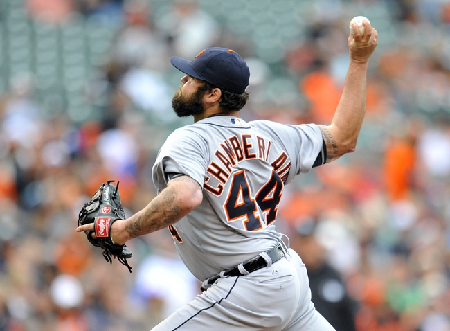 May 14, 2014; Baltimore, MD, USA; Detroit Tigers pitcher Joba Chamberlain (44) throws in the eighth inning against the Baltimore Orioles at Oriole Park at Camden Yards. The Tigers defeated the Orioles 7-5 completing the three game sweep. Mandatory Credit: Joy R. Absalon-USA TODAY Sports