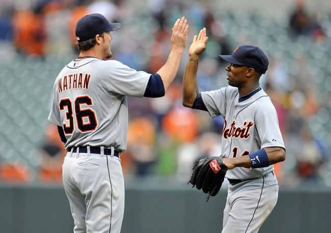 May 14, 2014; Baltimore, MD, USA; Detroit Tigers teammates Joe Nathan (36) and Austin Jackson (14) celebrate after a game against the Baltimore Orioles at Oriole Park at Camden Yards. The Tigers defeated the Orioles 7-5 completing the three game sweep. Mandatory Credit: Joy R. Absalon-USA TODAY Sports
