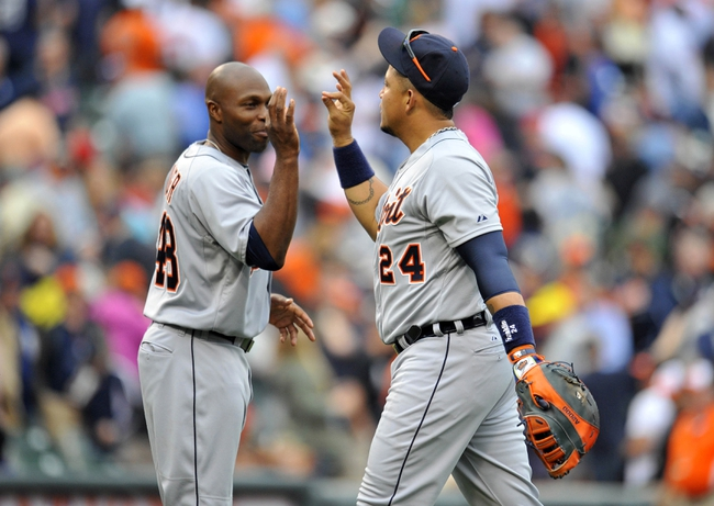 May 14, 2014; Baltimore, MD, USA; Detroit Tigers teammates Torii Hunter (48) and Miguel Cabrera (24) celebrate after a game against the Baltimore Orioles at Oriole Park at Camden Yards. The Tigers defeated the Orioles 7-5 completing the three game sweep. Mandatory Credit: Joy R. Absalon-USA TODAY Sports