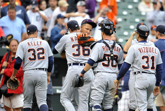 May 14, 2014; Baltimore, MD, USA; Detroit Tigers pitcher Joe Nathan (36) congratulates Miguel Cabrera (24) after a game against the Baltimore Orioles at Oriole Park at Camden Yards. The Tigers defeated the Orioles 7-5 completing the three game sweep. Mandatory Credit: Joy R. Absalon-USA TODAY Sports