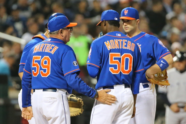 May 14, 2014; New York, NY, USA;  New York Mets pitching coach Dan Warthen (59)visits starting pitcher Rafael Montero (50) during the fourth inning against the New York Yankees at Citi Field. Mandatory Credit: Anthony Gruppuso-USA TODAY Sports