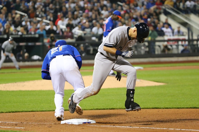 May 14, 2014; New York, NY, USA;  New York Yankees shortstop Derek Jeter (2) is out at first as New York Mets first baseman Lucas Duda (21) fields the throw during the fifth inning at Citi Field. Mandatory Credit: Anthony Gruppuso-USA TODAY Sports