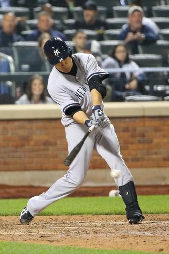 May 14, 2014; New York, NY, USA;  New York Yankees starting pitcher Masahiro Tanaka (19) singles to center during the ninth inning against the New York Mets at Citi Field. New York Yankees won 4-0.  Mandatory Credit: Anthony Gruppuso-USA TODAY Sports
