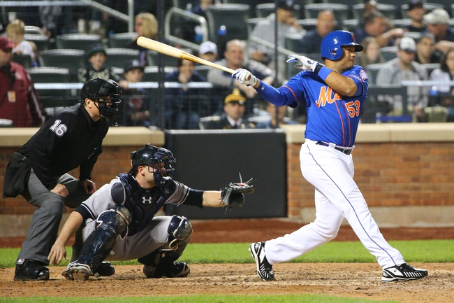 May 14, 2014; New York, NY, USA; New York Mets right fielder Bobby Abreu (53) singles to center during the ninth inning against the New York Yankees at Citi Field. New York Yankees won 4-0.  Mandatory Credit: Anthony Gruppuso-USA TODAY Sports