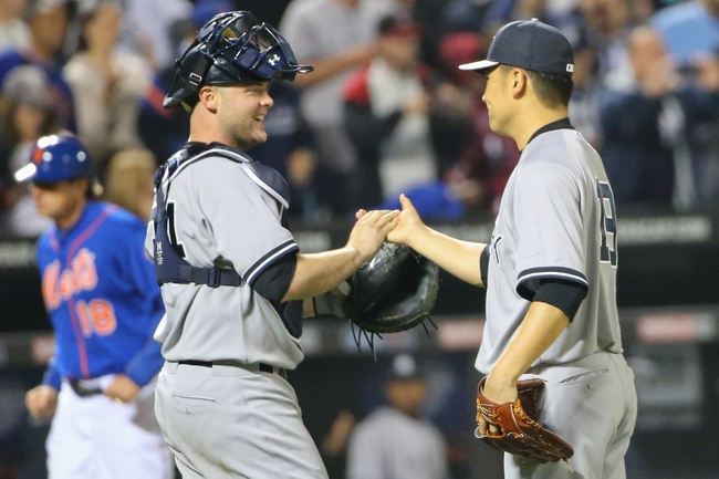 May 14, 2014; New York, NY, USA; New York Yankees starting pitcher Masahiro Tanaka (19) and catcher Brian McCann (34) celebrate the win against the New York Mets at Citi Field. New York Yankees won 4-0.  Mandatory Credit: Anthony Gruppuso-USA TODAY Sports