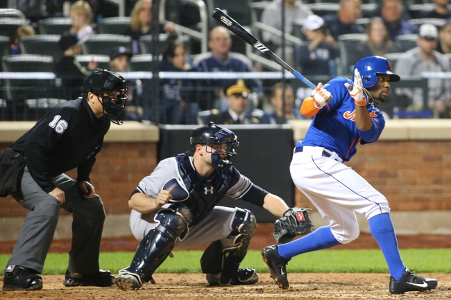 May 14, 2014; New York, NY, USA; New York Mets left fielder Eric Young Jr. (22) grounds into fielders choice to shortstop during the ninth inning against the New York Yankees at Citi Field. New York Yankees won 4-0.  Mandatory Credit: Anthony Gruppuso-USA TODAY Sports