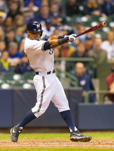 May 6, 2014; Milwaukee, WI, USA; Milwaukee Brewers left fielder Khris Davis (18) bats during the game against the Arizona Diamondbacks at Miller Park.  Arizona won 7-5.  Mandatory Credit: Jeff Hanisch-USA TODAY Sports