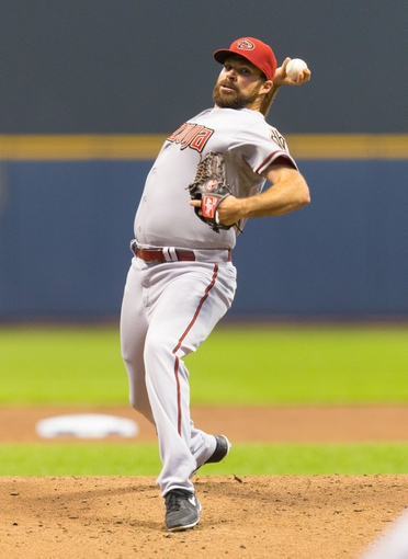May 6, 2014; Milwaukee, WI, USA; Arizona Diamondbacks pitcher Josh Collmenter (55) during the game against the Milwaukee Brewers at Miller Park.  Arizona won 7-5.  Mandatory Credit: Jeff Hanisch-USA TODAY Sports
