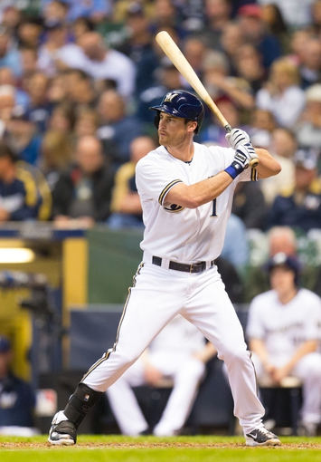 May 6, 2014; Milwaukee, WI, USA; Milwaukee Brewers left fielder Logan Schafer (1) bats during the game against the Arizona Diamondbacks at Miller Park.  Arizona won 7-5.  Mandatory Credit: Jeff Hanisch-USA TODAY Sports