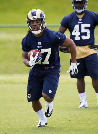 May 16, 2014; St. Louis, MO, USA; St. Louis Rams running back Tre Mason (27) during rookie minicamp at Rams Park. Mandatory Credit: Scott Rovak-USA TODAY Sports