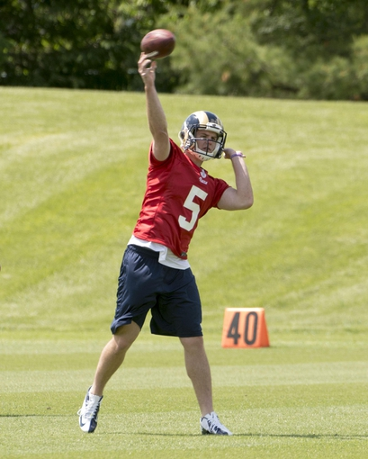 May 16, 2014; St. Louis, MO, USA; St. Louis Rams quarterback Garrett Gilbert (5) during rookie minicamp at Rams Park. Mandatory Credit: Scott Rovak-USA TODAY Sports