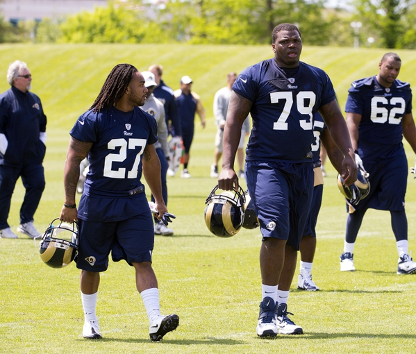 May 16, 2014; St. Louis, MO, USA; St. Louis Rams running back Tre Mason (27) and offensive lineman Greg Robinson (79) during rookie minicamp at Rams Park. Mandatory Credit: Scott Rovak-USA TODAY Sports